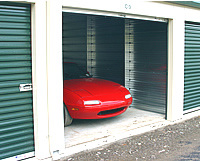 Photo of a red car in a storage unit
